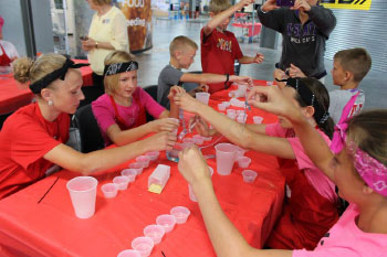 Students conducting a science experiment at one of the many events held at Raising Nebraska in 2015.